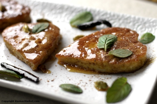 almond breadcrumb fritters with ceylon cinnamon and mint garnish