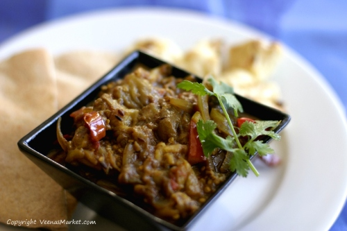 Roasted eggplant curry served with pita bread