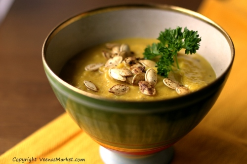 pumpkin soup with spicy tahini garnished with garam masala roasted squash seeds